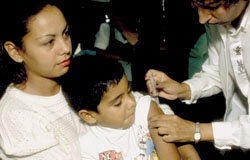 Boy receives measles vaccine in Venezuela